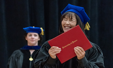 smiling student with diploma